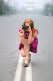 Girl-photographer takes pictures on town Stock Photography