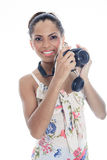 Girl-photographer takes snaps, isolated on white Royalty Free Stock Photography