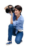 Girl-photographer takes snaps Royalty Free Stock Photo