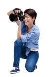 Girl-photographer takes snaps Royalty Free Stock Photo