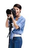 Girl-photographer takes snapshots Royalty Free Stock Photo
