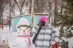 Girl photographer in winter Stock Photo