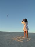 Girl photographing. Young woman photographing an airplane Stock Photography