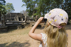 Girl Photographing Ancient Temple Royalty Free Stock Photos