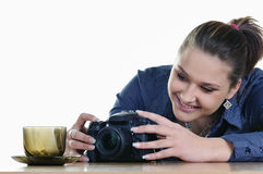 Girl photographing an empty cup Stock Photo