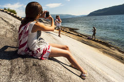 Girl photographing Royalty Free Stock Image