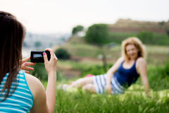 Girl photographing a friend Royalty Free Stock Photography