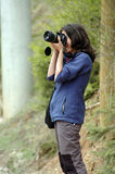 Girl photographing in the nature