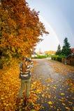 Girl photographing the rainbow Stock Photo