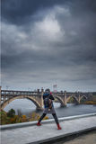 Girl photographs Bridge. Across the Dnieper River dreary, cloudy day Stock Image