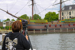 Girl photographs the exhibits of the Netherlands Maritime Museum Royalty Free Stock Photo