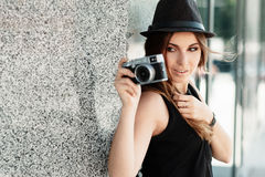 Girl  photographs  with the mirrorless digital camera Royalty Free Stock Photos
