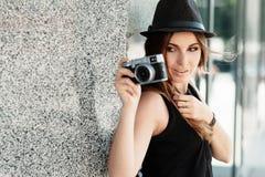 Girl  photographs  with the mirrorless digital camera Royalty Free Stock Photos