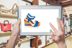 Girl photographs, sandals, shoes online shopping. A royalty free stock image