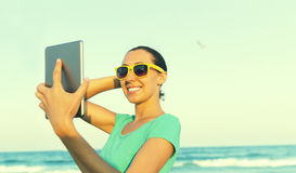 Girl photographs selfie Royalty Free Stock Photo