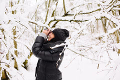 Girl photographs in winter forest Royalty Free Stock Image
