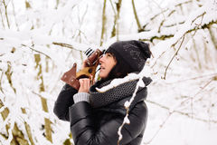 Girl photographs in winter forest Royalty Free Stock Photos