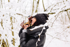 Girl photographs in winter forest Stock Photos