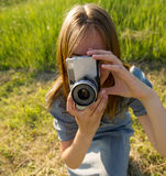 Girl photographs. Young, beautiful woman traveler photographed natural scenes Royalty Free Stock Photo
