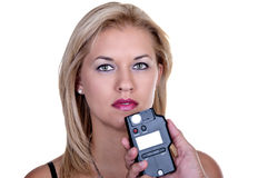 Girl with a photometer Royalty Free Stock Image