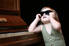 Girl and piano Stock Photography