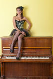 Girl on the piano Stock Photos