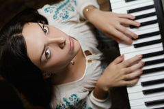 Girl and piano. royalty free stock photos