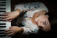 Girl and piano. stock photo