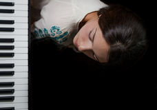 Girl and piano. Royalty Free Stock Photography