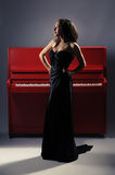 Girl on the piano Royalty Free Stock Photos