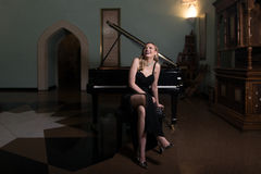 Girl and Piano Stock Photo