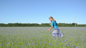 Girl pick flowers field Royalty Free Stock Photos