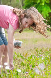 Girl picking berries. Girl picking fresh berries in field Stock Photography