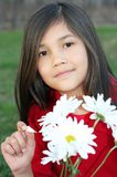 Girl picking daisies Stock Image