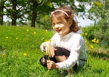 Girl picking flowers Stock Photos