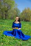 Girl picking flowers. The photo shows a girl picking flowers Royalty Free Stock Images