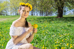 Girl picking flowers. The photo shows a girl picking flowers Stock Photography
