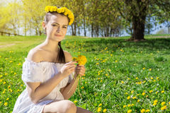 Girl picking flowers. The photo shows a girl picking flowers Royalty Free Stock Photo