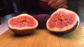 Girl picking the half of fig. 4K close up shot stock footage