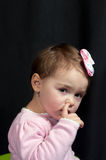 Girl picking her nose Royalty Free Stock Photo