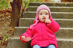 Girl picking her nose Stock Images