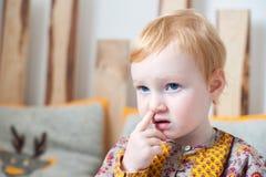 Girl picking her nose Royalty Free Stock Image