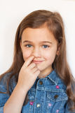 Girl Picking His Nose. Little Six Year Girl Picking His Nose On White Background, Looking Smilingly At Camera Close-up Stock Photography