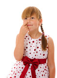 Girl picking nose. Seven years girl picking nose isolated Royalty Free Stock Photos