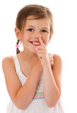 Girl picking nose. Seven years girl picking nose isolated Stock Images