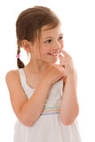 Girl picking nose. Seven years girl picking nose isolated Royalty Free Stock Images