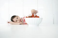 Girl Picking Strawberries From Bowl Stock Image