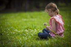 Girl Picking Wild Flowoers Royalty Free Stock Photo