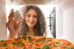 Girl pickle pizza Stock Image