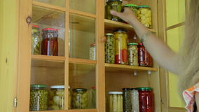 Girl pickled food shelf Royalty Free Stock Photos